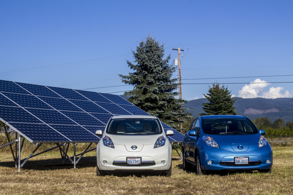 Our two Nissan LEAFs in front of our solar panels, at the end of Day 3