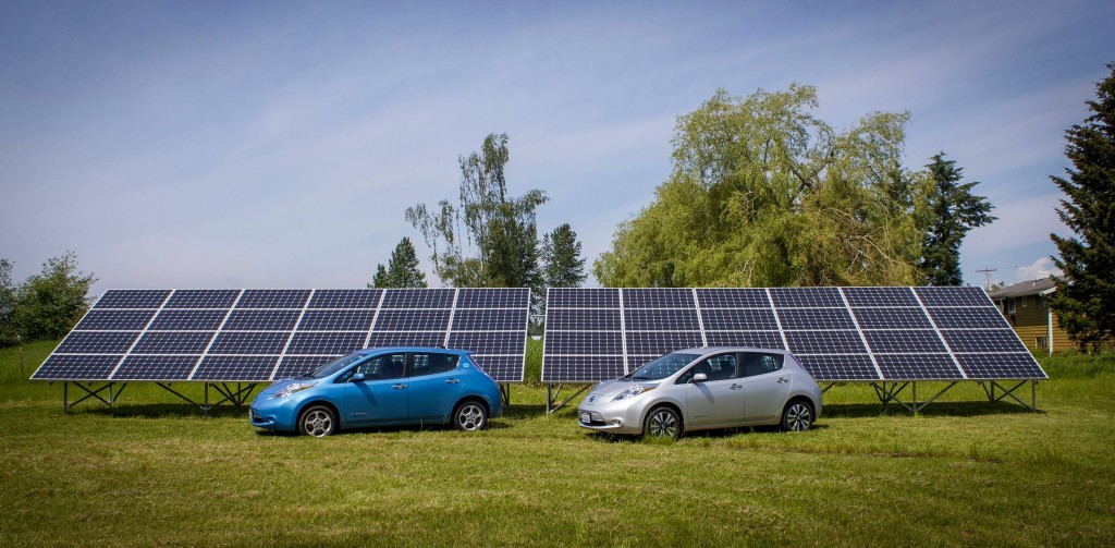 Our two Nissan LEAFs in front of our solar array.